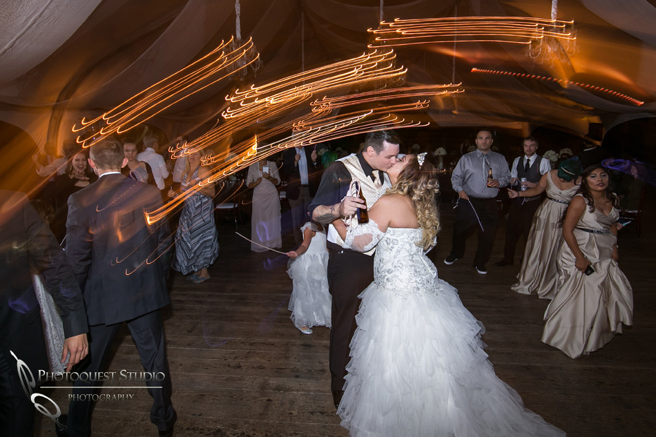 Kissing on the dance floor by Fallbrook, Temecula Wedding Photographer