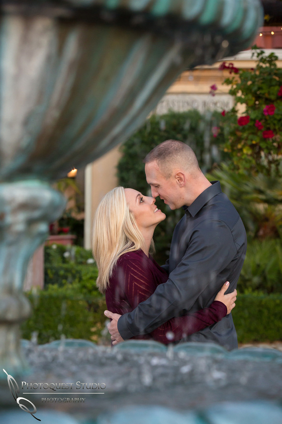 Touching noses at the sunset and the fountain at Engagement photo at South Coast Winery, California by Temecula Wedding Photographers