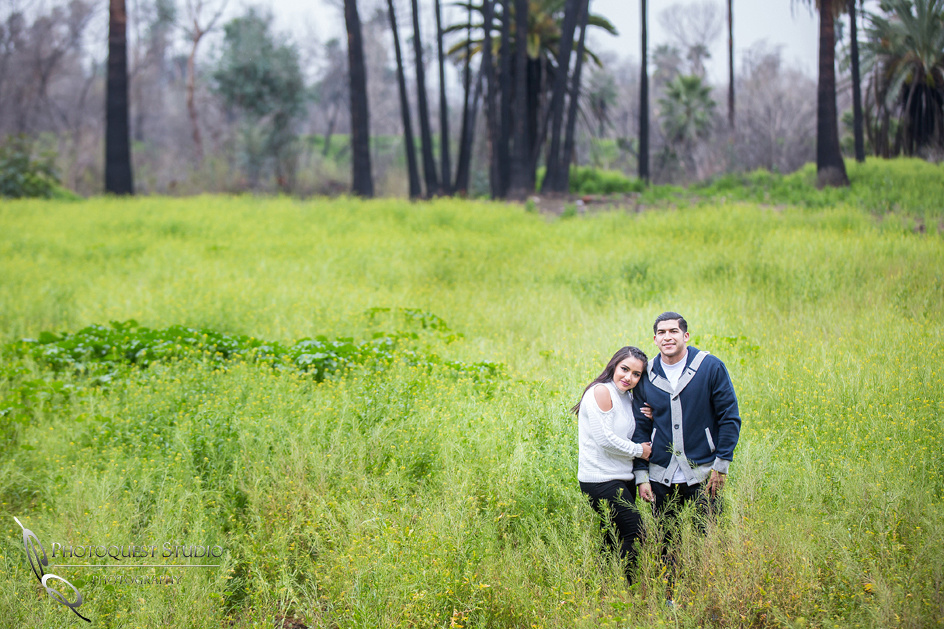 Engagement photo with flowers by Temecula wedding photographer