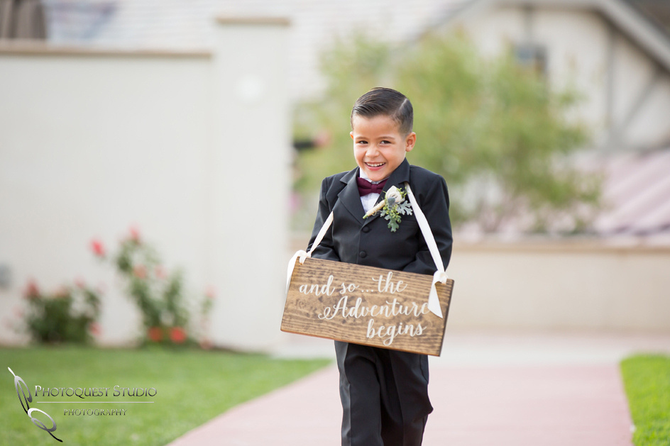 Cute ring boy by  Temecula Winery wedding Photographer