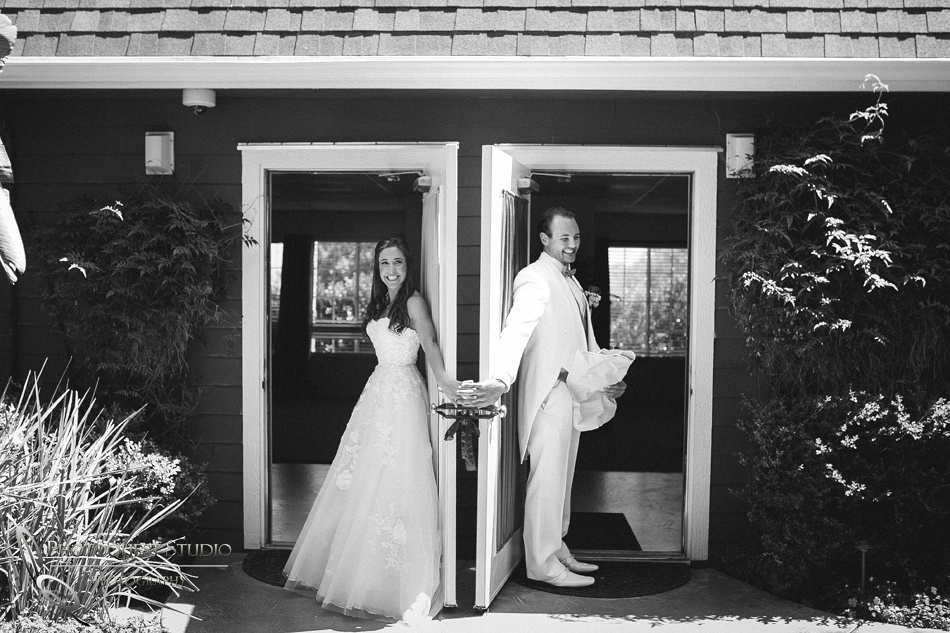 holding hands behind the door on wedding day in fallbrook