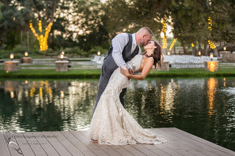 Kissing Wedding photo at Lake Oak Meadows, Temecula Winery by Photographer of Photoquest Studio