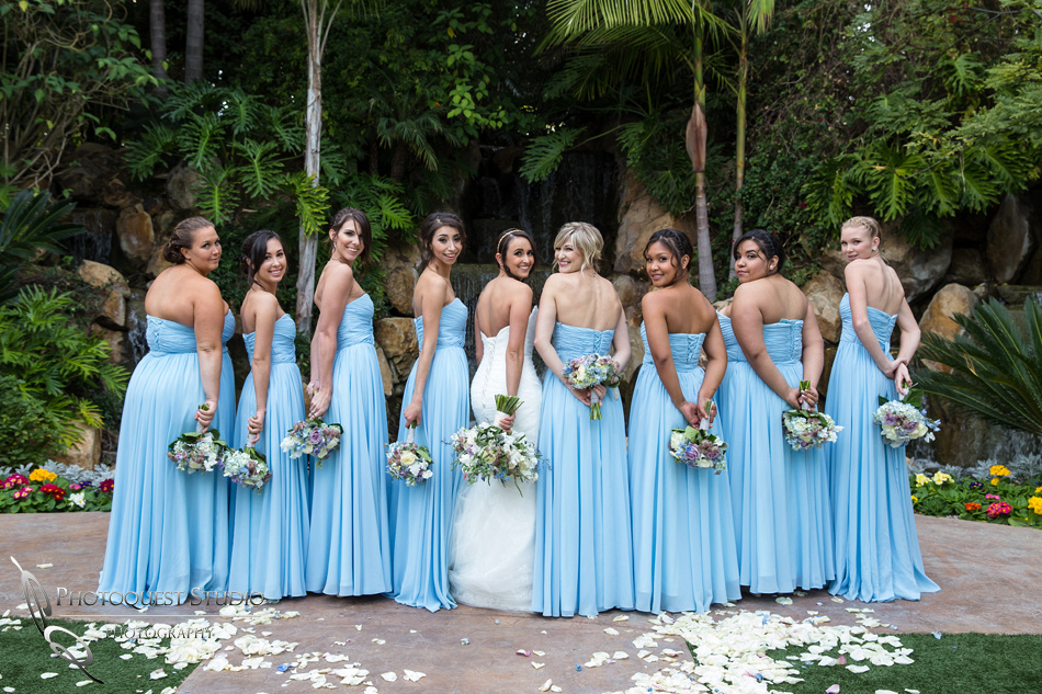 Flowers and Blue dresses. Wedding photos at Grand Tradition Estate Fallbrook by Wedding Photographer in Temecula