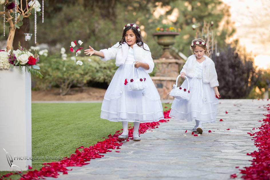 Flower girls in white dresses