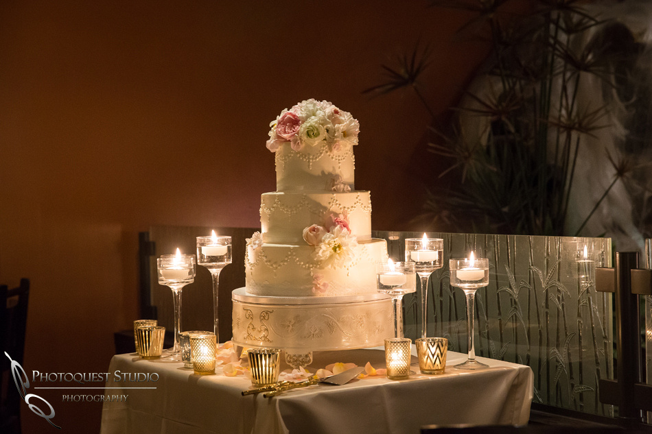 wedding cake with candle at Brodard Chateau Wedding