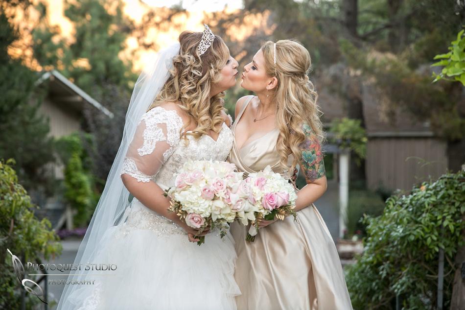 Bride and Bridesmaid kissing by Fallbrook, Temecula Wedding Photographer