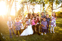 bride and groom kiss while kids are crying at Falkner winery wine wedding by temecula wedding photographer