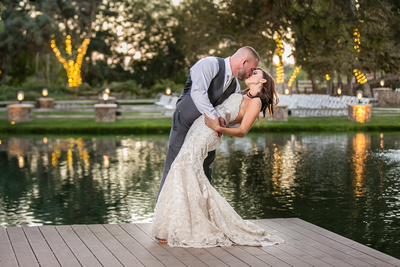 Dipping and kissing by the lake in Temecula by Lake Oak Meadows Wedding Photographer
