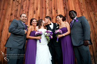 bride and groom kissing and the bridal party cheering at Falkner winery wine wedding by temecula wedding photographer