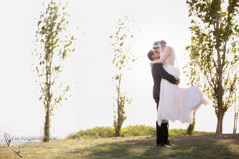 holding and kissing by temecula wedding photographer