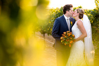 Bride-and-Groom-kissing-behind-the-vine-at-Mount-Palomar-Temecula-Winery-Wedding